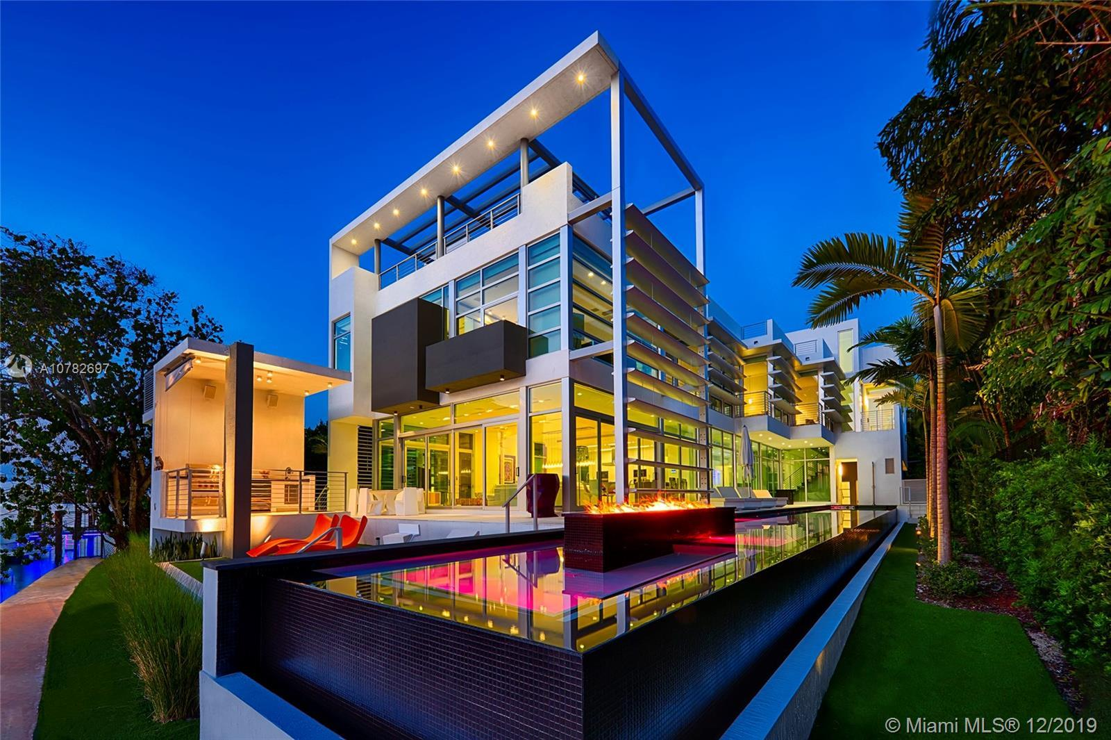 This sleek ultra-modern tri-level waterfront masterpiece sits on the coveted tip of guard gated Hibi
