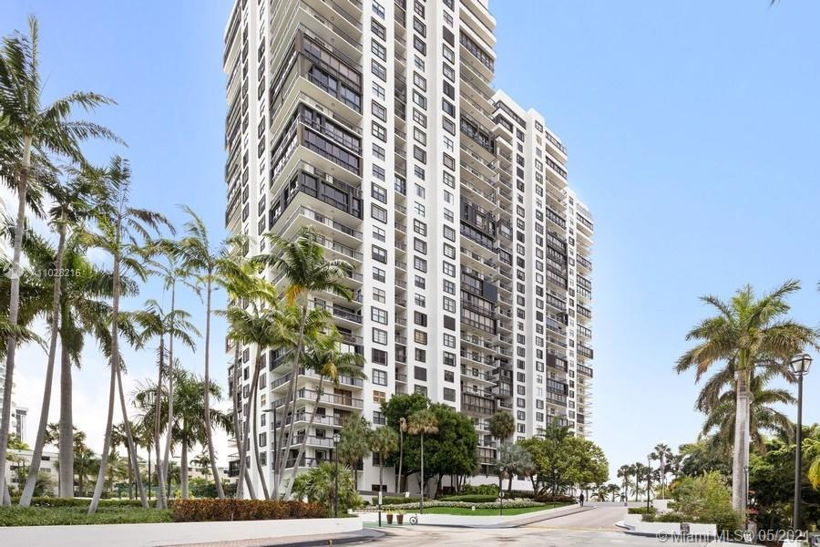 Spacious corner unit with enclosed balconies has sensational views of Biscayne Bay. 