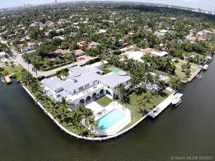"One of the largest waterfront estates on a 1+acre corner triple lot with 450"" of redone water-fronta"