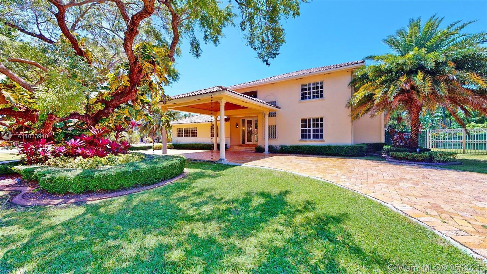 SITUATED IN EXCLUSIVE GABLES BY THE SEA COMMUNITY, THIS CORNER LOT SANCTUARY OFFERS 7 BEDROOMS & 6.5