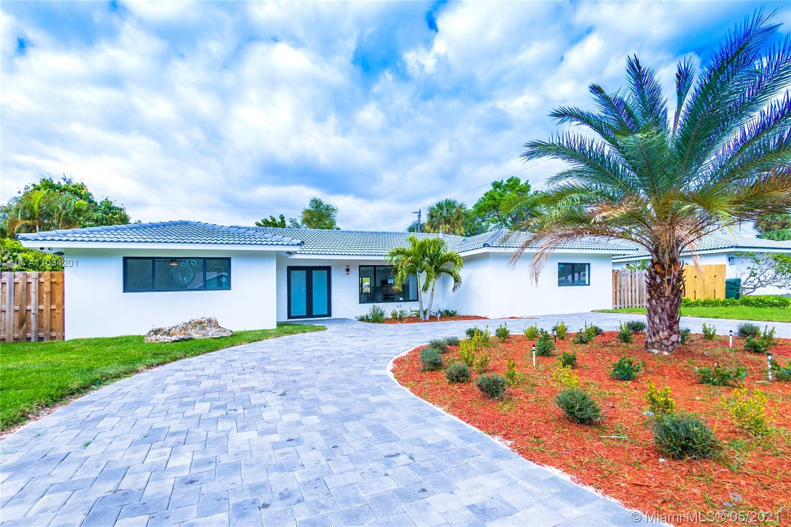Come and see this tastefully remodeled home with large open floor plan, in a great neighborhood on a