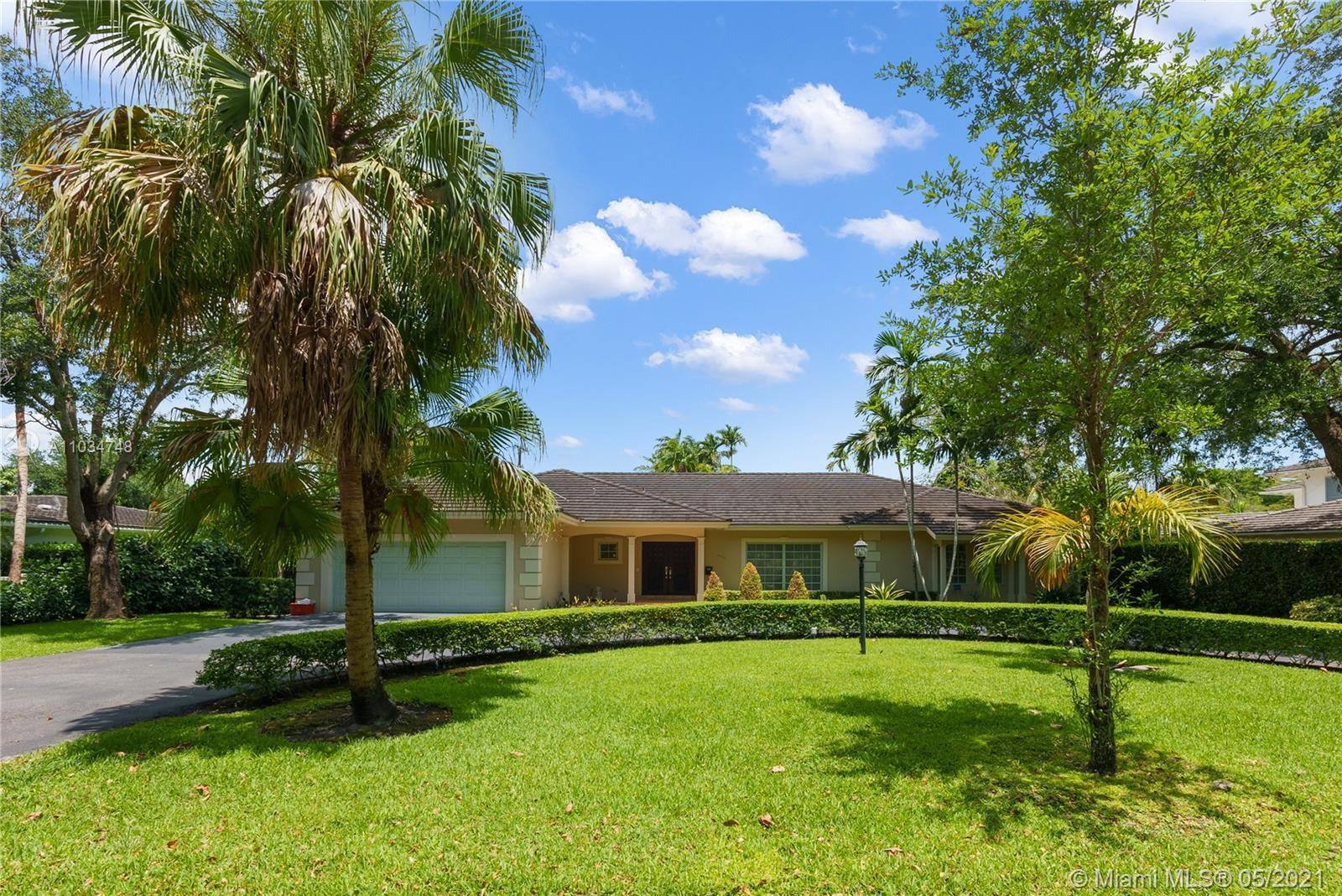 Perfect for a large family, spacious one-story home with split plan and pool on a quiet charming str
