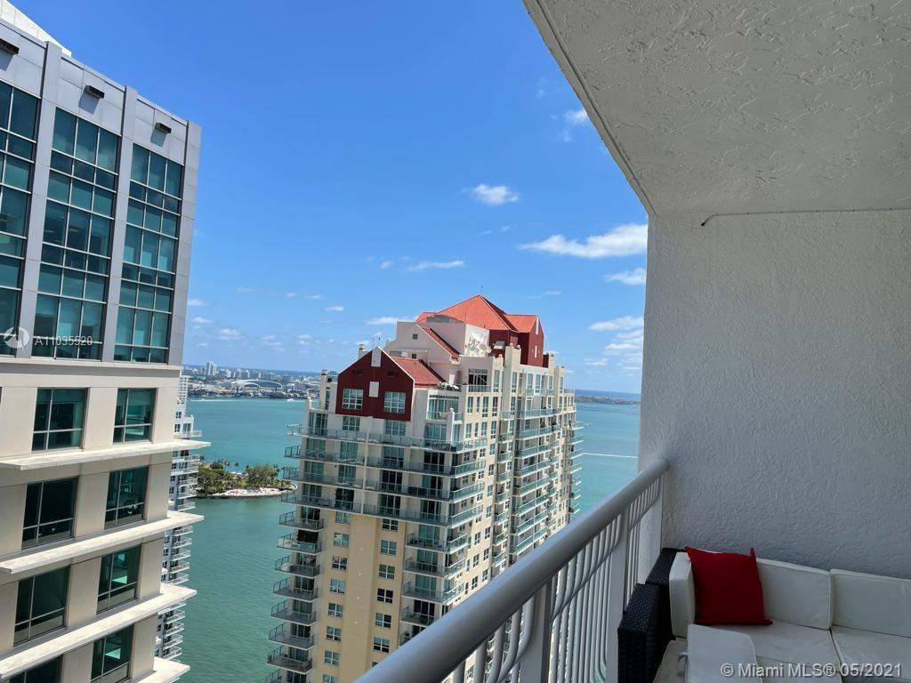 Rare 39th floor, highly desirable 12 line with water & city view.  Spacious floorplan with oversized