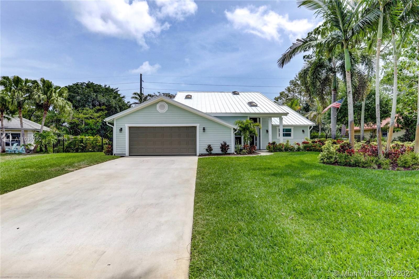 """SPECTACULAR 5 bedroom, 3 bath, TOTALLY RENOVATED Key West Style POOL home in Upscale, """"WHISPERING TR"""