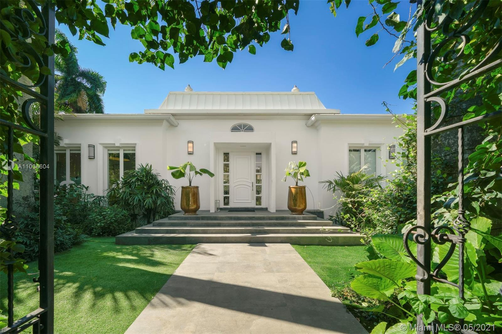 Elegant and dramatic pool home on Fabulous La Gorce Island.  Total of 6 bedrooms, 5 in the main hous