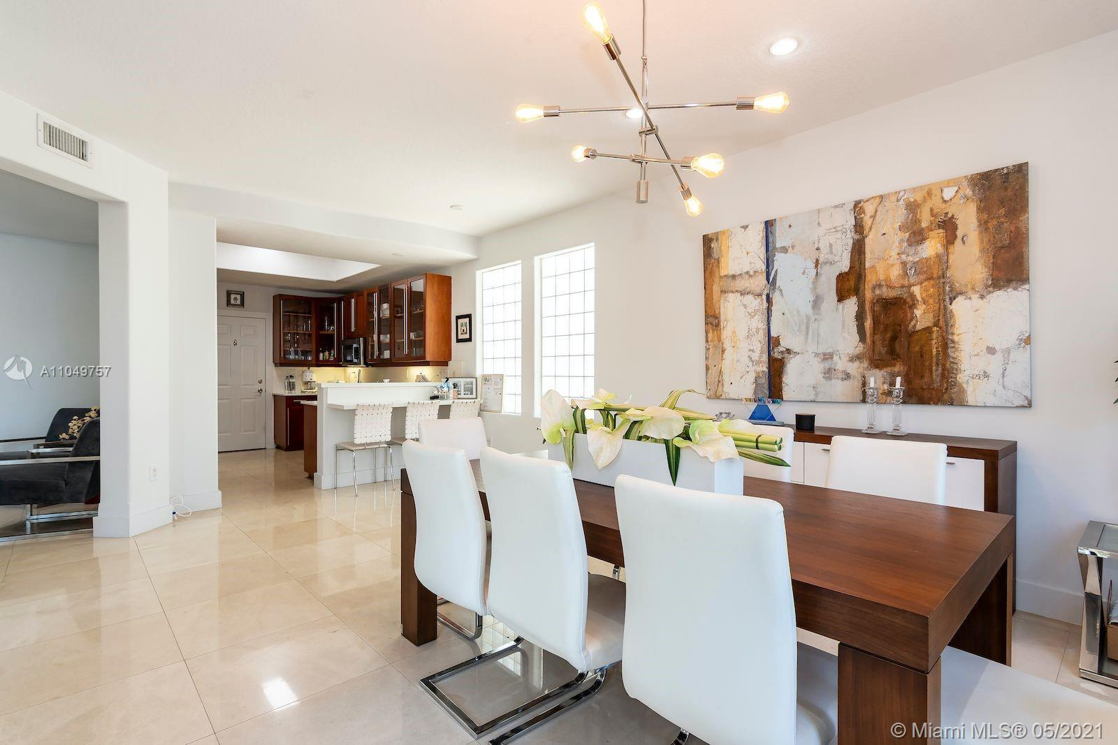 Amazing 4 bed 3.5 baths plus staff's quarter; in  the spectacular Gated community of Aventura Lakes.