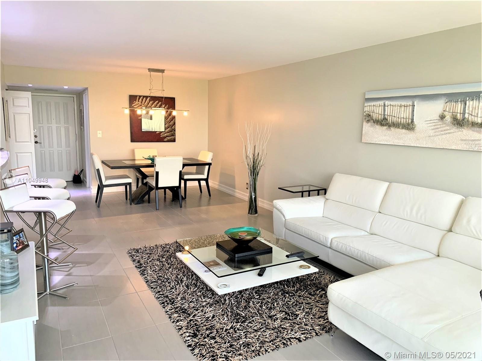 WOW!! This totally remodeled unit is move in ready. Exquisitely designed with porcelain flooring, op