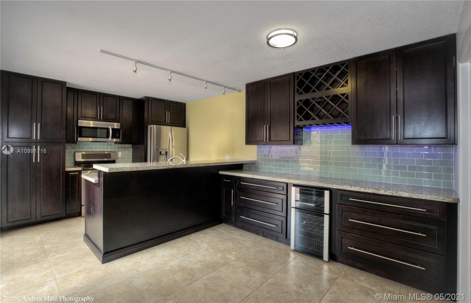 Beautiful fully REMODELED townhouse in a quiet and well-maintained complex in West Palm Beach. MOVE-