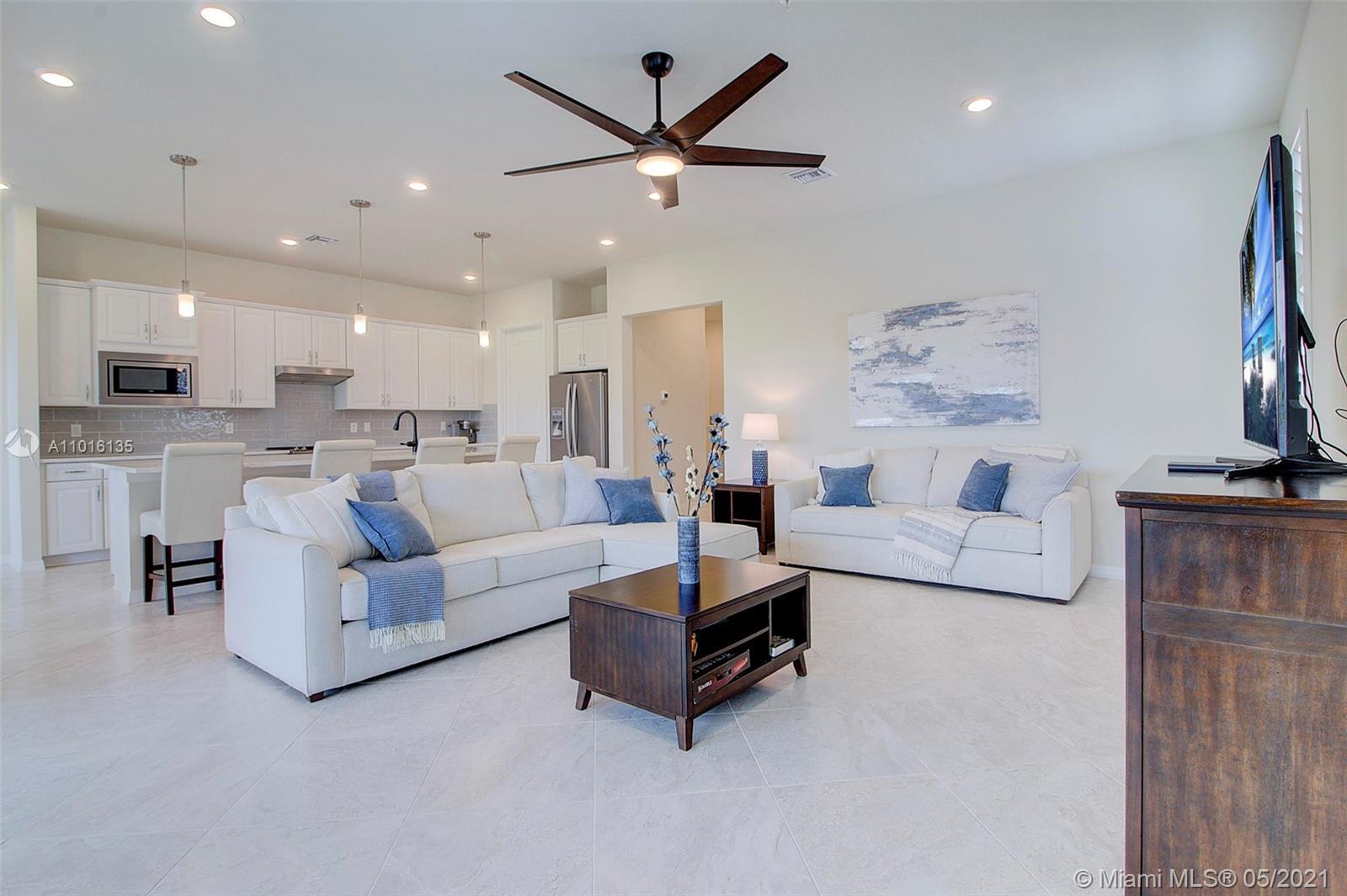 Luxurious 55+ Boca Flores. Desirable Westgate model features 3 bedrooms +Flex Room, 2.5 baths, 2 car