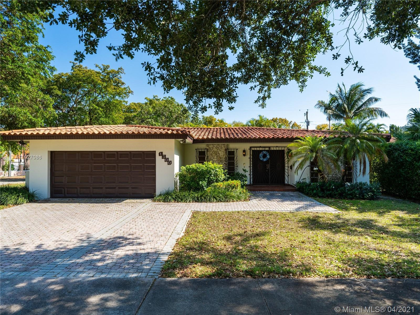 Charming home located on a large corner lot in the extremely desirable neighborhood of Coral Gables.