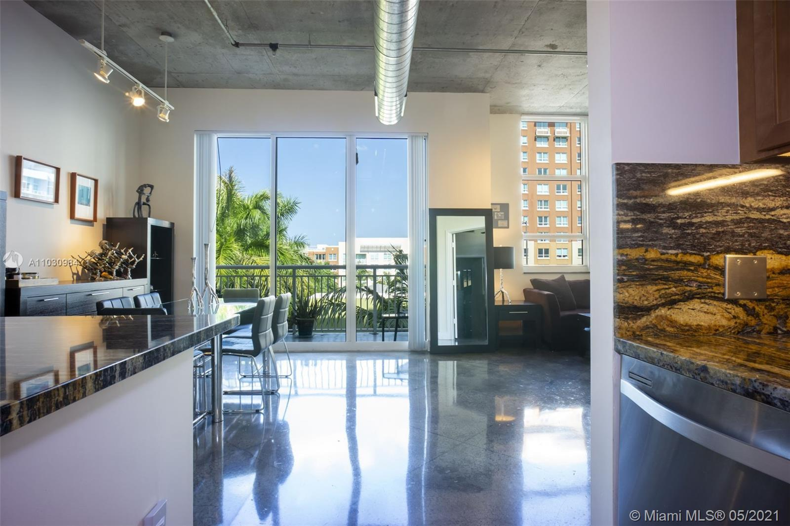 "Spectacular renovated 2bd, 2 bath NY style condo w/ 11' ceilings. Polished concrete floors w/ 6"" bas"