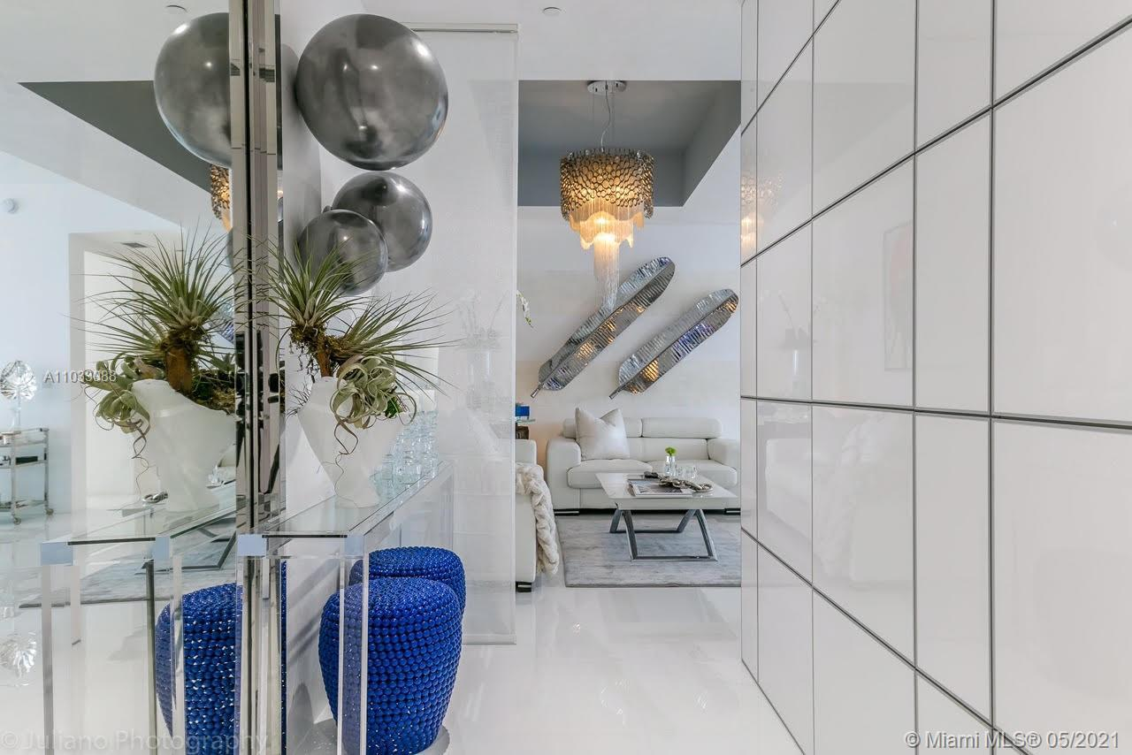 Exit the private elevator and enter this tastefully fully furnished, remodeled & decorated unit incl