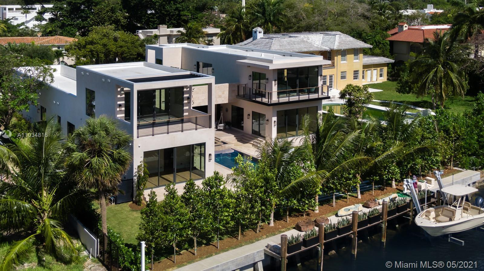 Stunning waterfront 2021 new construction on a huge 19,595 SF lot with 100FT of waterfront on quiet