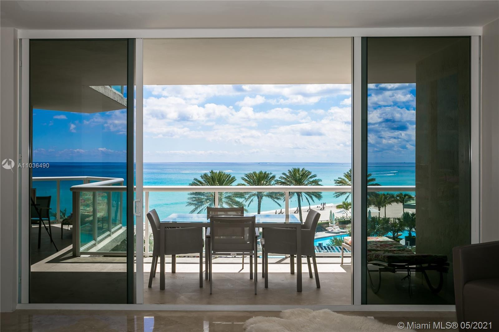 Come live the dream beachfront life! have your breakfast on your spacious wraparound balcony looking