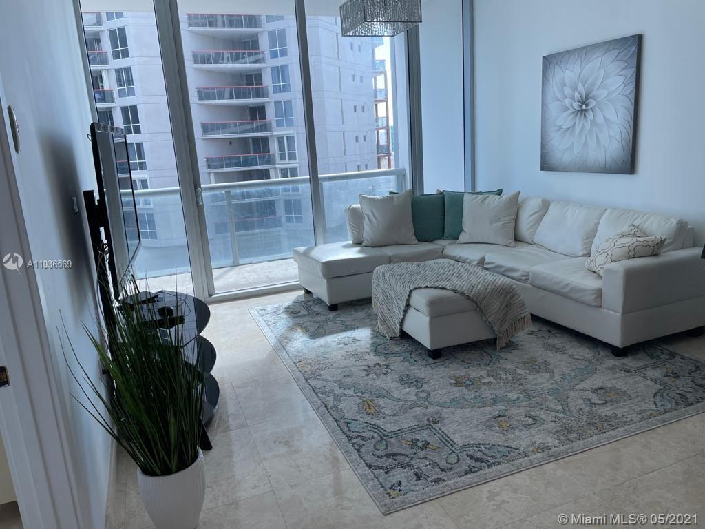 This is a beautiful condo at Carillon Wellness Resort.  Enjoy the beach and city view from your priv