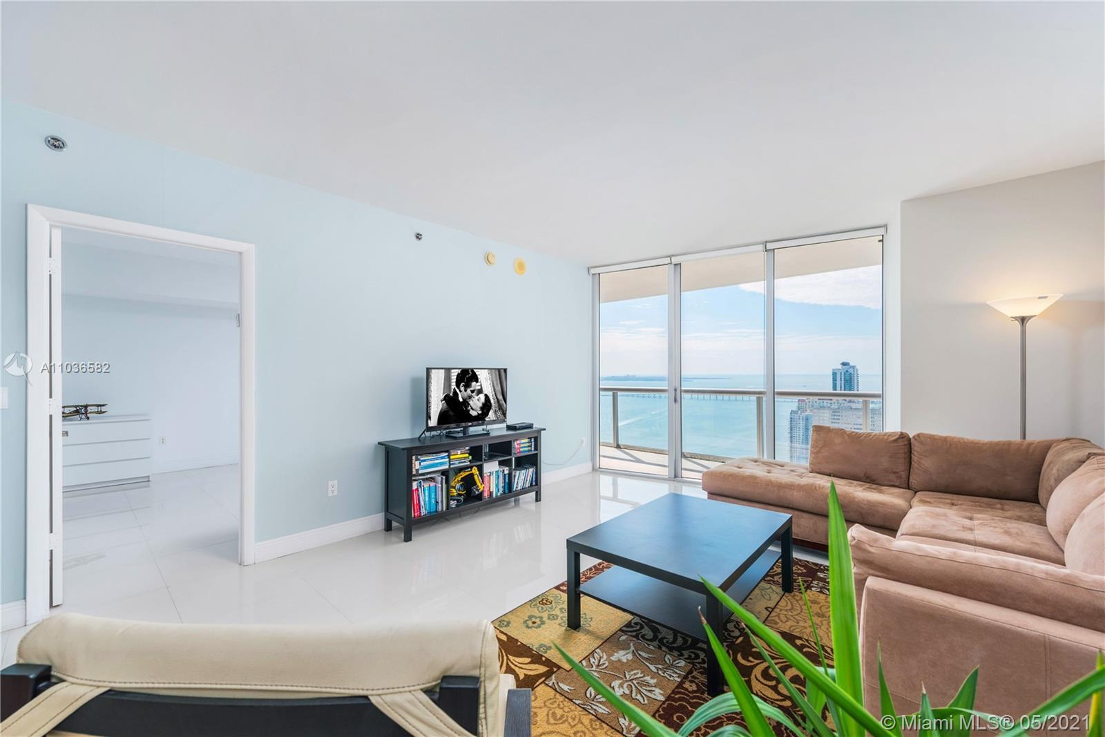 A spacious & bright 1 Bed, 1 Bath condo w/ over 1,000 interior square feet; white porcelain tiled fl