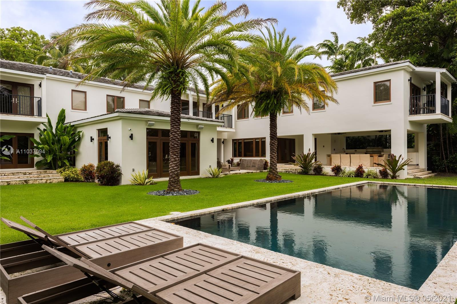 FULLY RENOVATED, 2-STORY WATERFRONT HOME ON A PRIVATE AND GATED COMPOUND LOCATED ON SUNSET ISLAND I.
