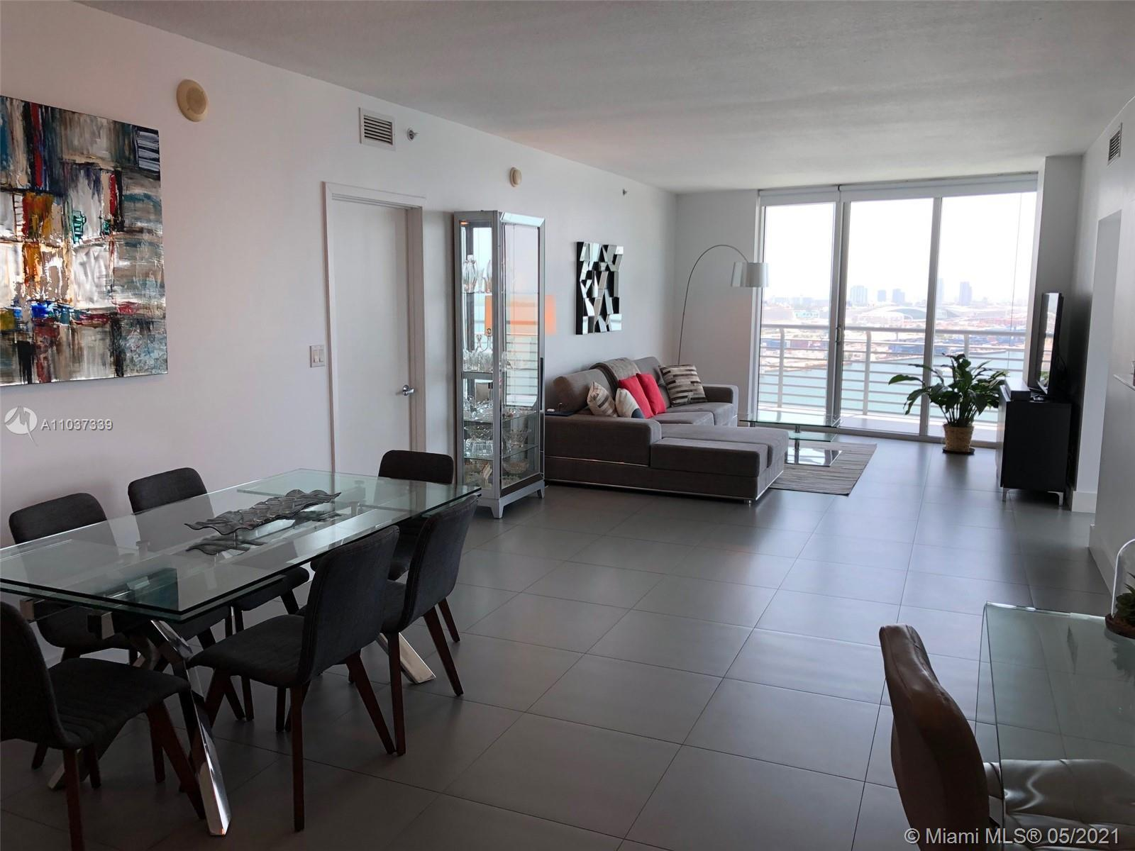 Spacious 3/2 amazing views & wrap around terrace. Center of everything. Just steps to Brickell, down