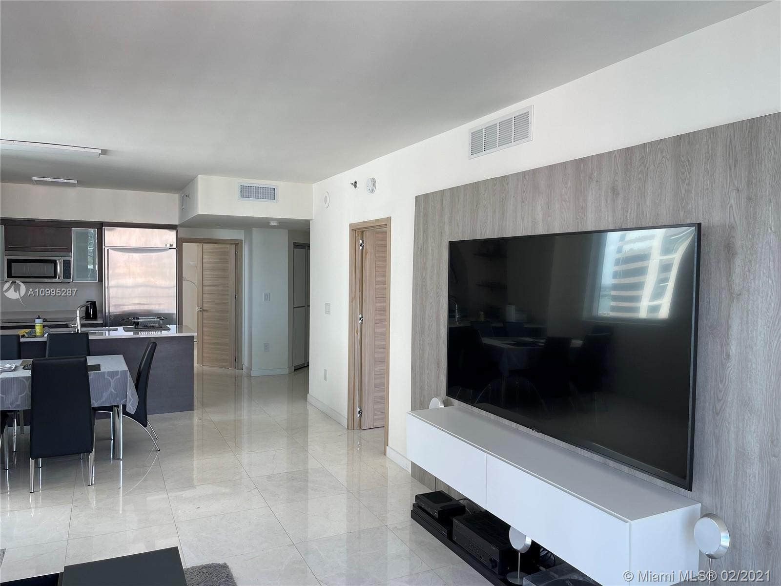 EXCEPTIONAL RENOVATED UNIT! 2 BED/2 BATH FACING THE RIVER AND MIAMI'S SKYLINE. CUSTOM MADE ITALIAN D