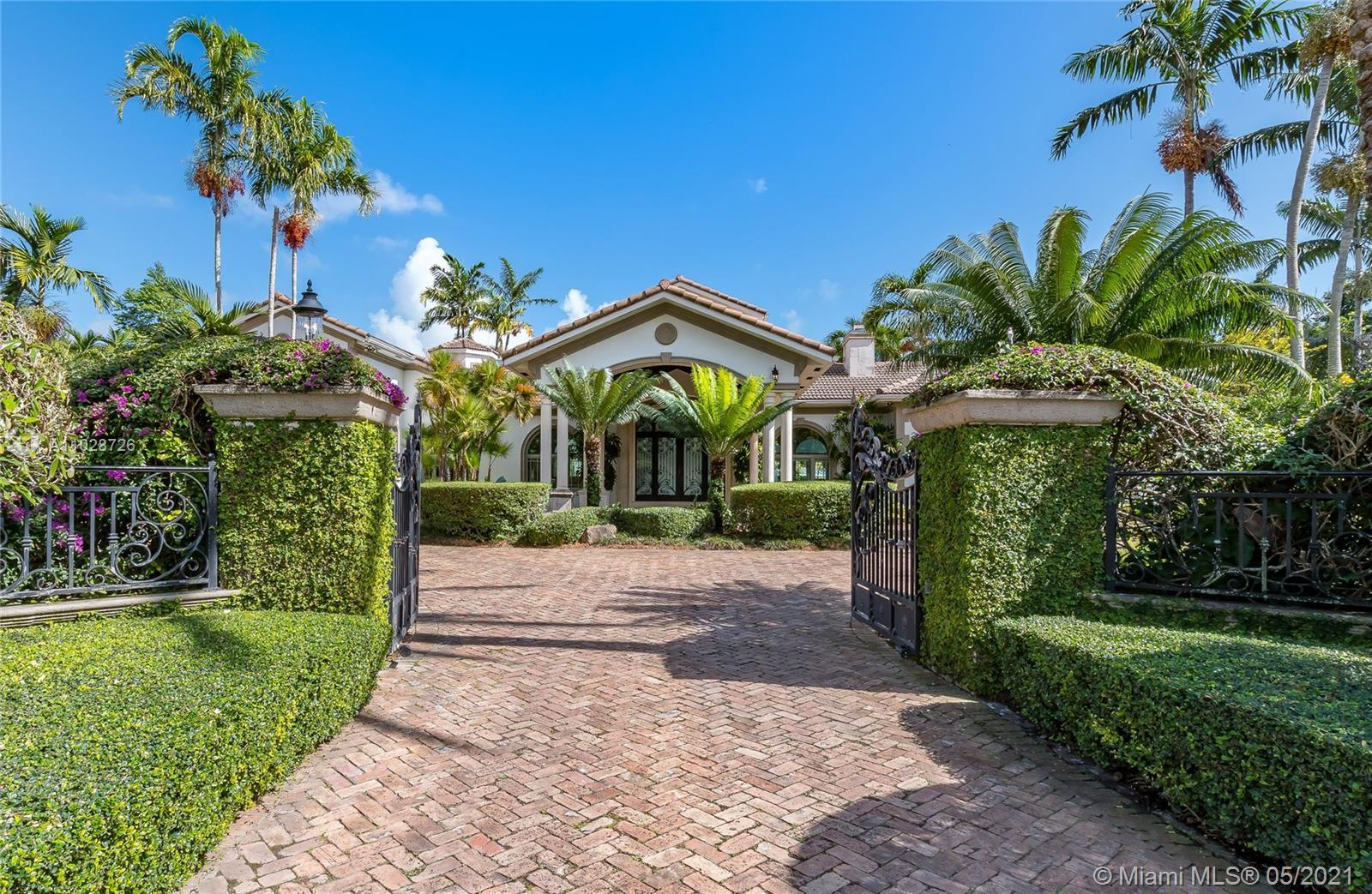 This spacious one story home located in N Pinecrest is privately gated & sits on 36,590 sqft of land