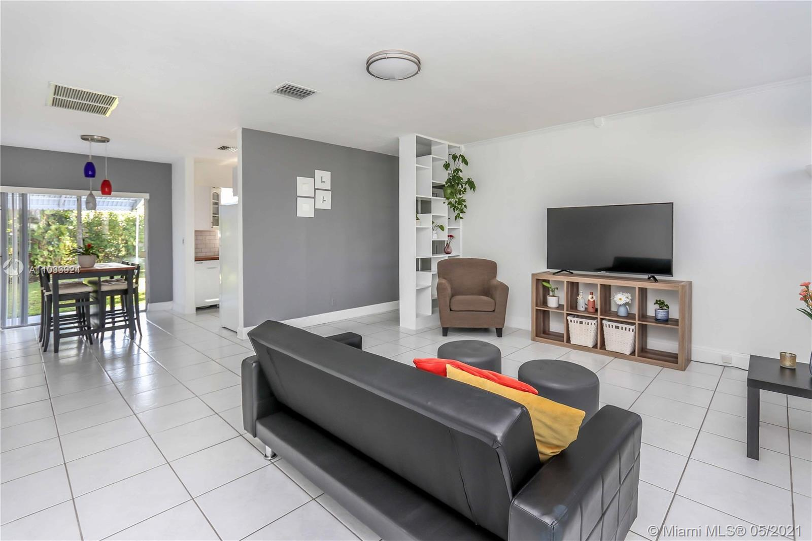 Spacious and Bright 2 bed. 1 bath. with 1 car garage home in the Hollywood Lakes area! This house fe