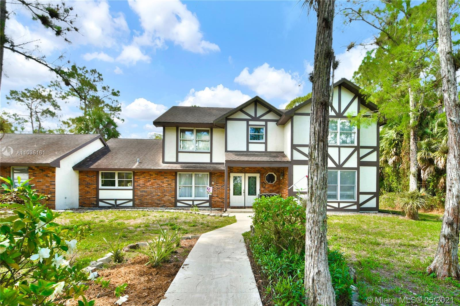 Remarkable architecture beauty on 2 acres in highly sought after Loxahatchee Groves.  Actual AC squa