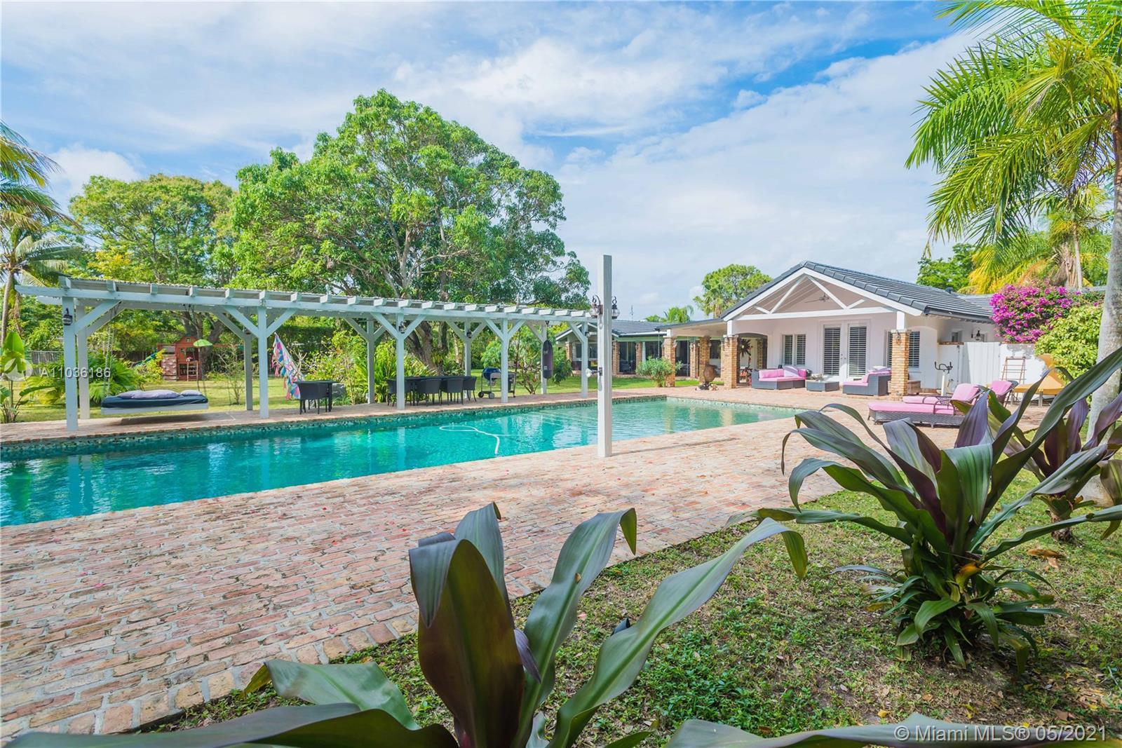 Coconut Grove meet Pinecrest! Totally renovated in 2017 with over $525K in updates. This gorgeous ne