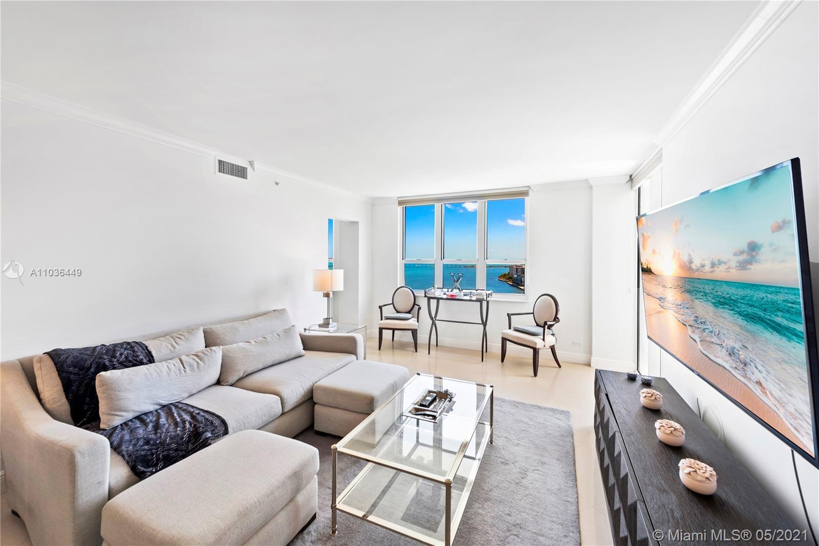 Enjoy breathtaking water views from this stunning 3/2.5 corner residence at the luxurious Courvoisie