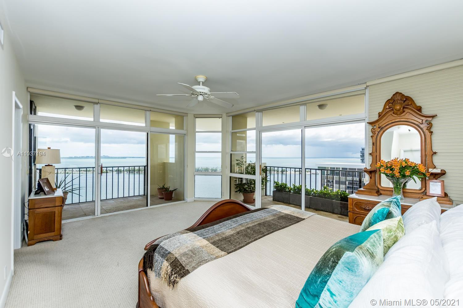 Breathtaking 360 degree water views from this fabulous 2 story penthouse on the tree-lined south end