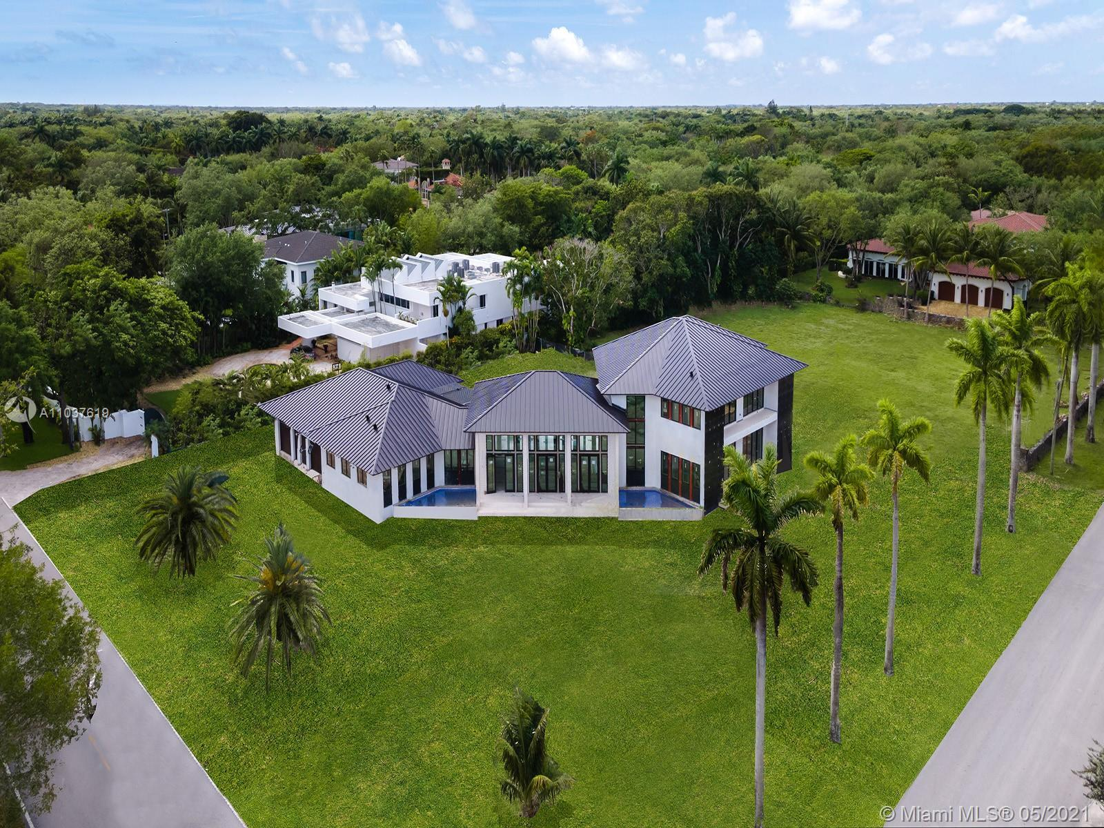 This gracious new-built residence, sprawling across a generous property in the heart of Miami's pres