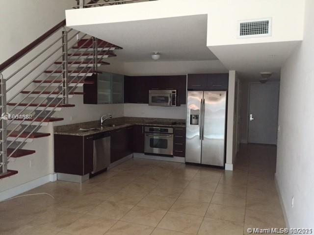 BEAUTIFUL LOFT STYLE 1/1.5 UNIT IN THE HEART OF BRICKELL. UNIT HAS CERAMIC FLOORS, STAINLESS STEEL A