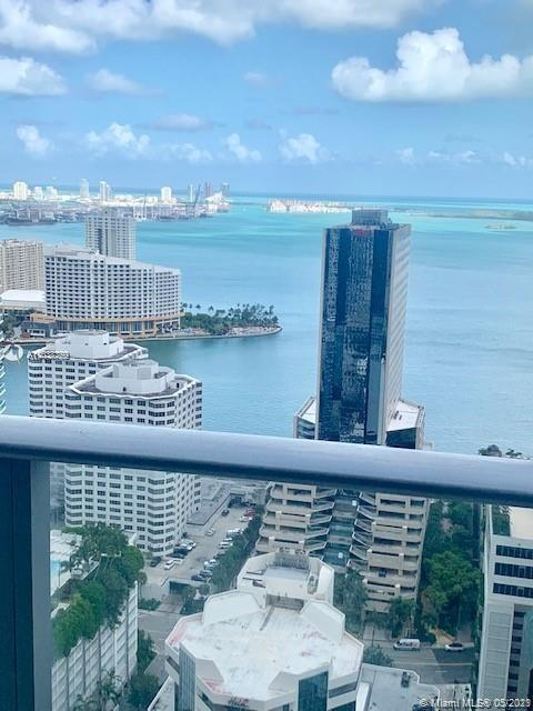 Spectacular unit at the iconic 1010 Brickell Condo. Unit features: 2 beds, 3 baths + den, amazing vi