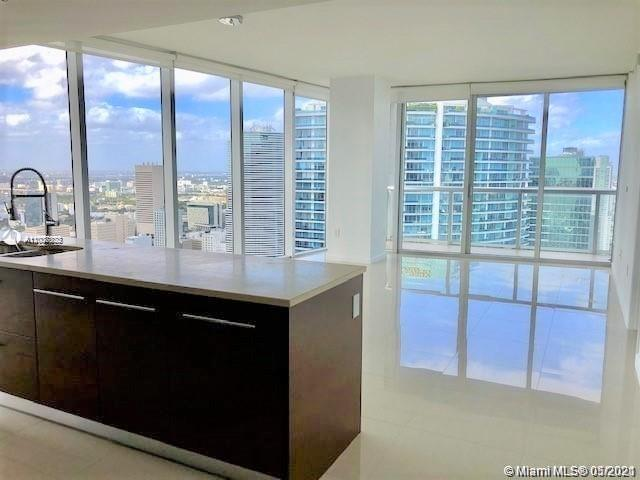 Investors Opportunity!! Dont miss this amazing 2/2 corner unit with marble flooring, European kitche