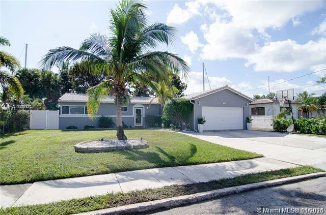 Tastefully renovated, waterfront home in desirable Citrus Isles. Located minutes to downtown Ft. Lau