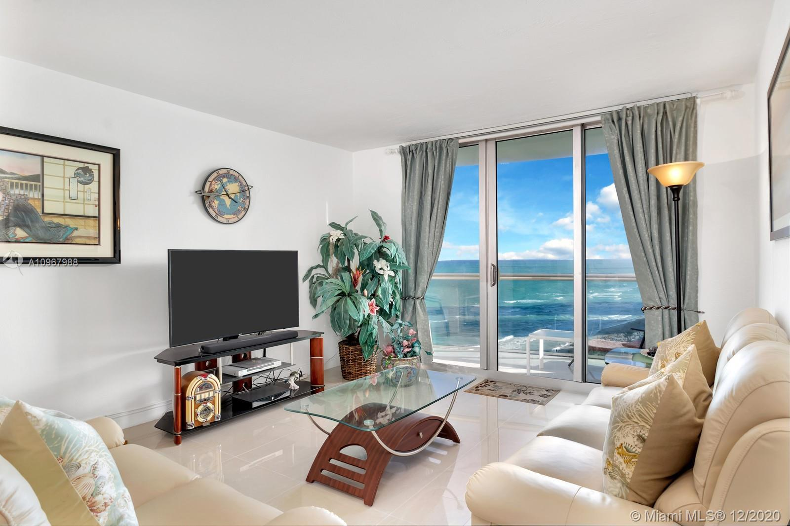 Magnificent direct ocean views, immaculate modern decor, popular Hollywood Beach location and an abu