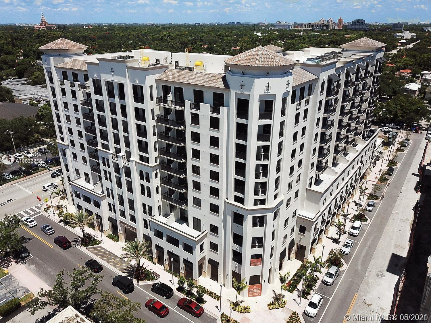 BRAND NEW two-bedroom developer unit with large enclosed terrace in Coral Gables' chic Shops of Merr
