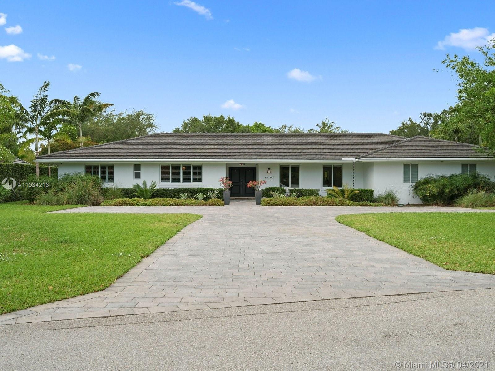 Stunning 5 bedroom, 4 bathroom Pinecrest estate home. 4,081 SF of under-air living space and 6,008 t