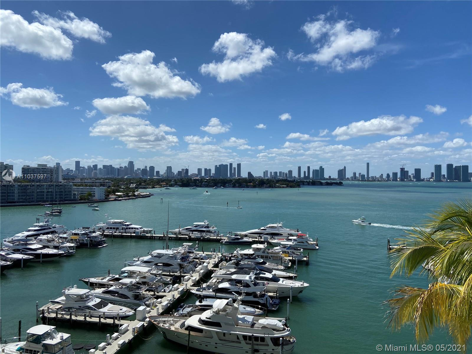 Rare Sunset Harbour bay facing unit in pristine condition. Enjoy spectacular sunsets from your balco