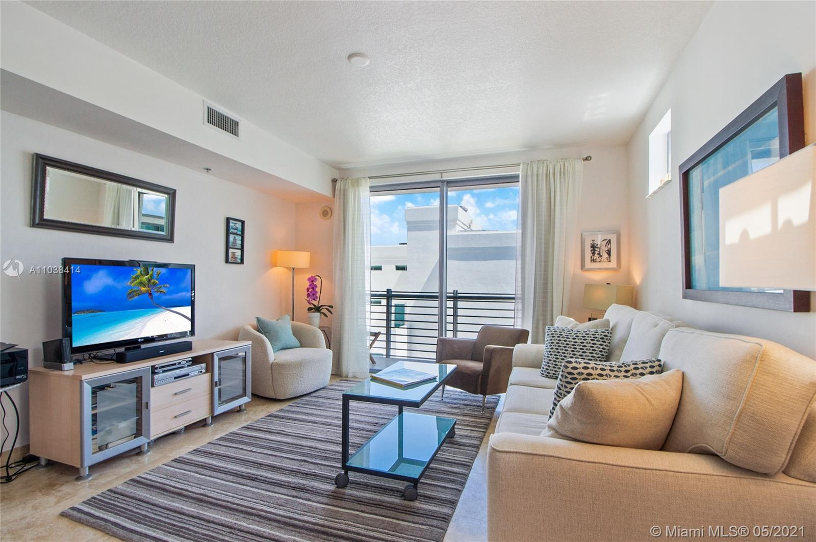 Located in the coveted South of fifth neighborhood, this top floor, sun filled unit features an open