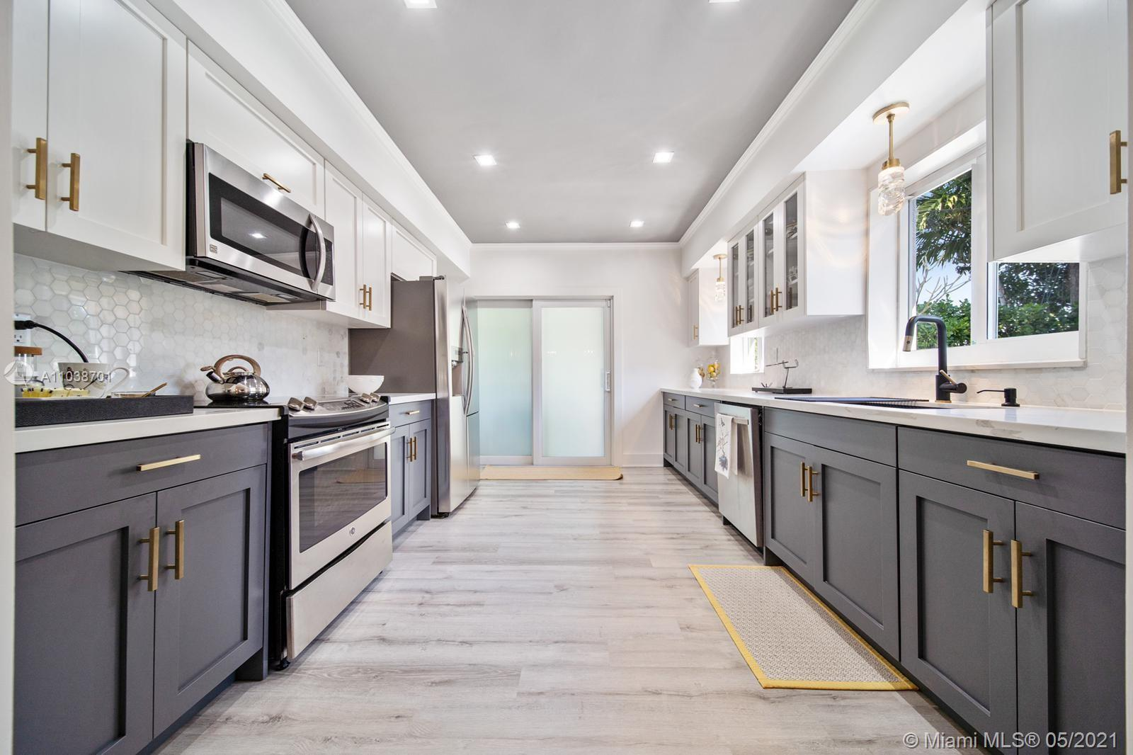 COMPLETELY REMODELED. New Kitchen + Bathrooms + Floors. Charming 2BD + 2BA.  One oversize living roo