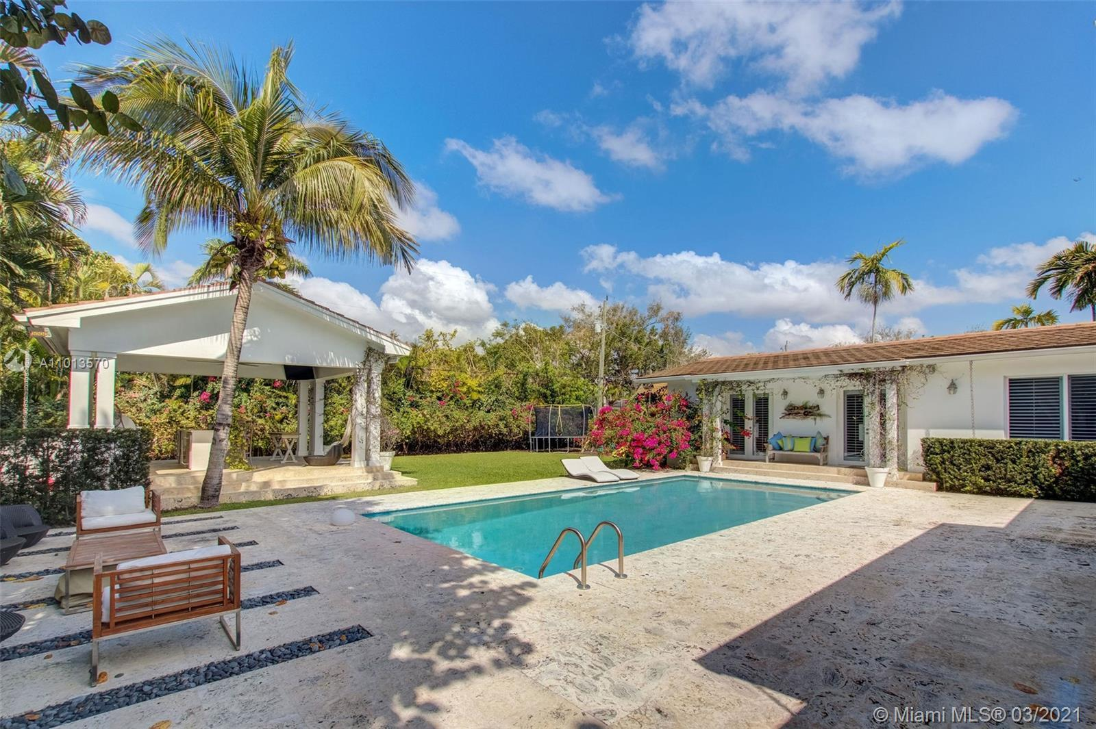 Plantation style home with huge spaces. All 5 bedrooms have en suite bathrooms. Gorgeous backyard wi