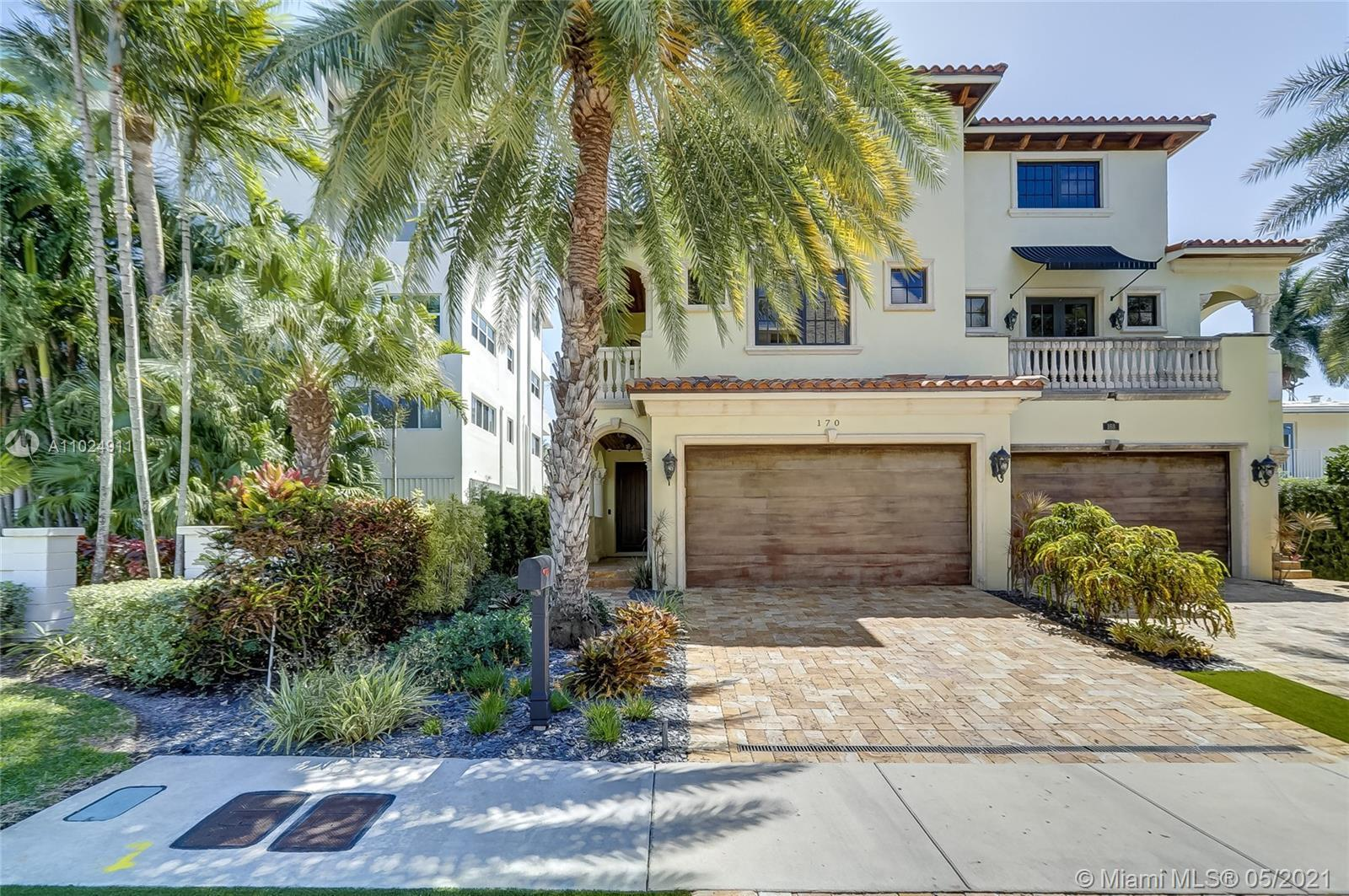 Gorgeous 3 Story townhome with stunning rooftop terrace with views of downtown Fort Lauderdale. This