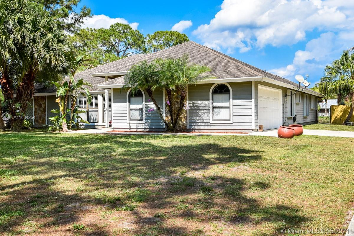 Gorgeous Pool Home in highly desirable Jupiter Farms! Home features 4 Bedrooms 3 Baths on 1.25 Acres