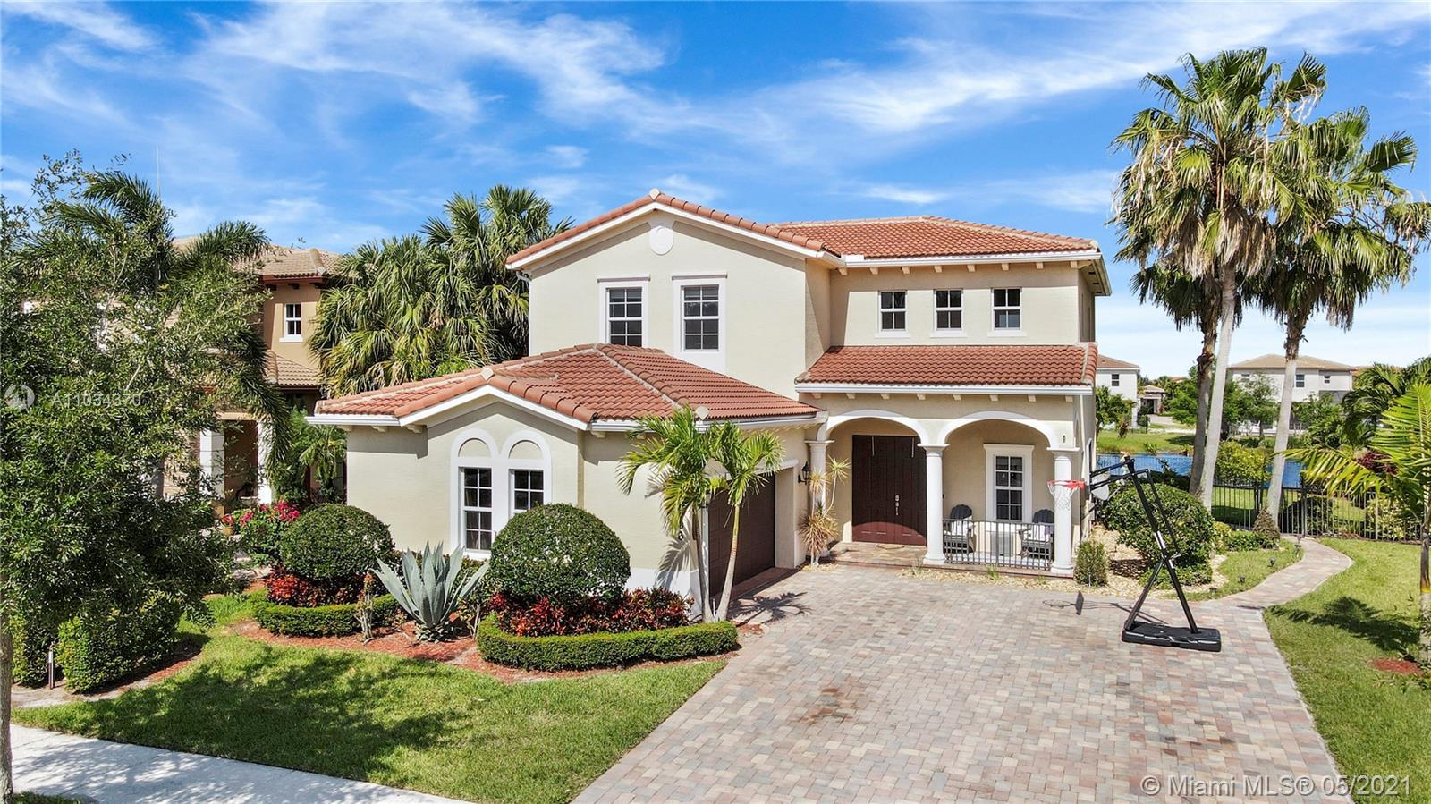 Welcome Home to Rialto, Jupiter's Premier Gated Community!! Located on the Lake, this San Marco Mode
