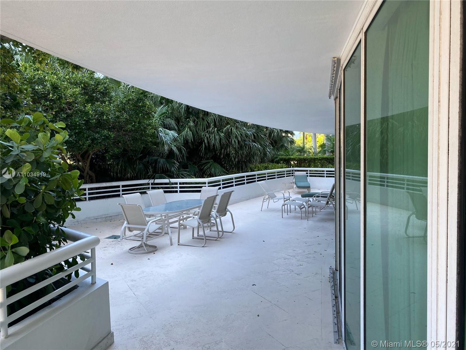 This luxurious 2 bedroom and 3.5 bath lanai unit has the largest terrace surrounded by lush greenery