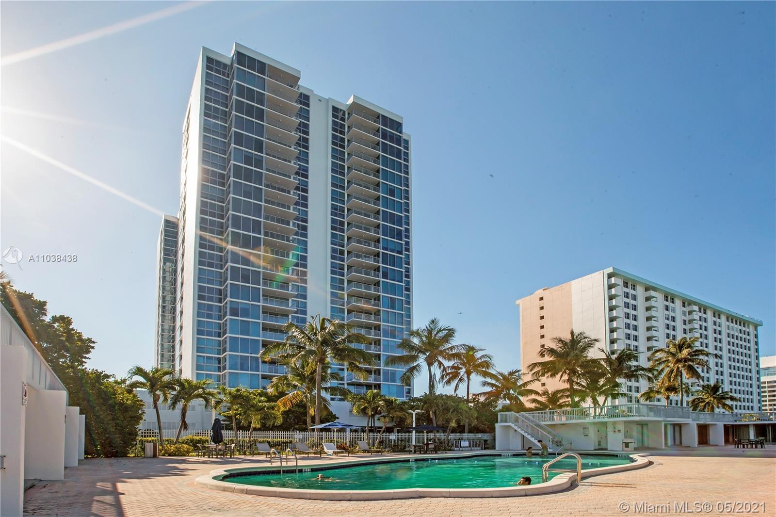 Spacious, bright and airy 2 bed+den corner unit in the Mirasol.  New high impact windows have been i