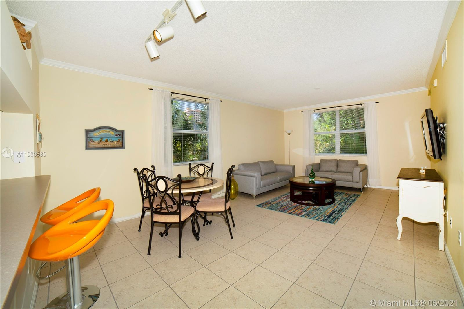 2 bedroom 2 bath corner unit in the heart of Sunny Isles, tile floors in the living dining room and
