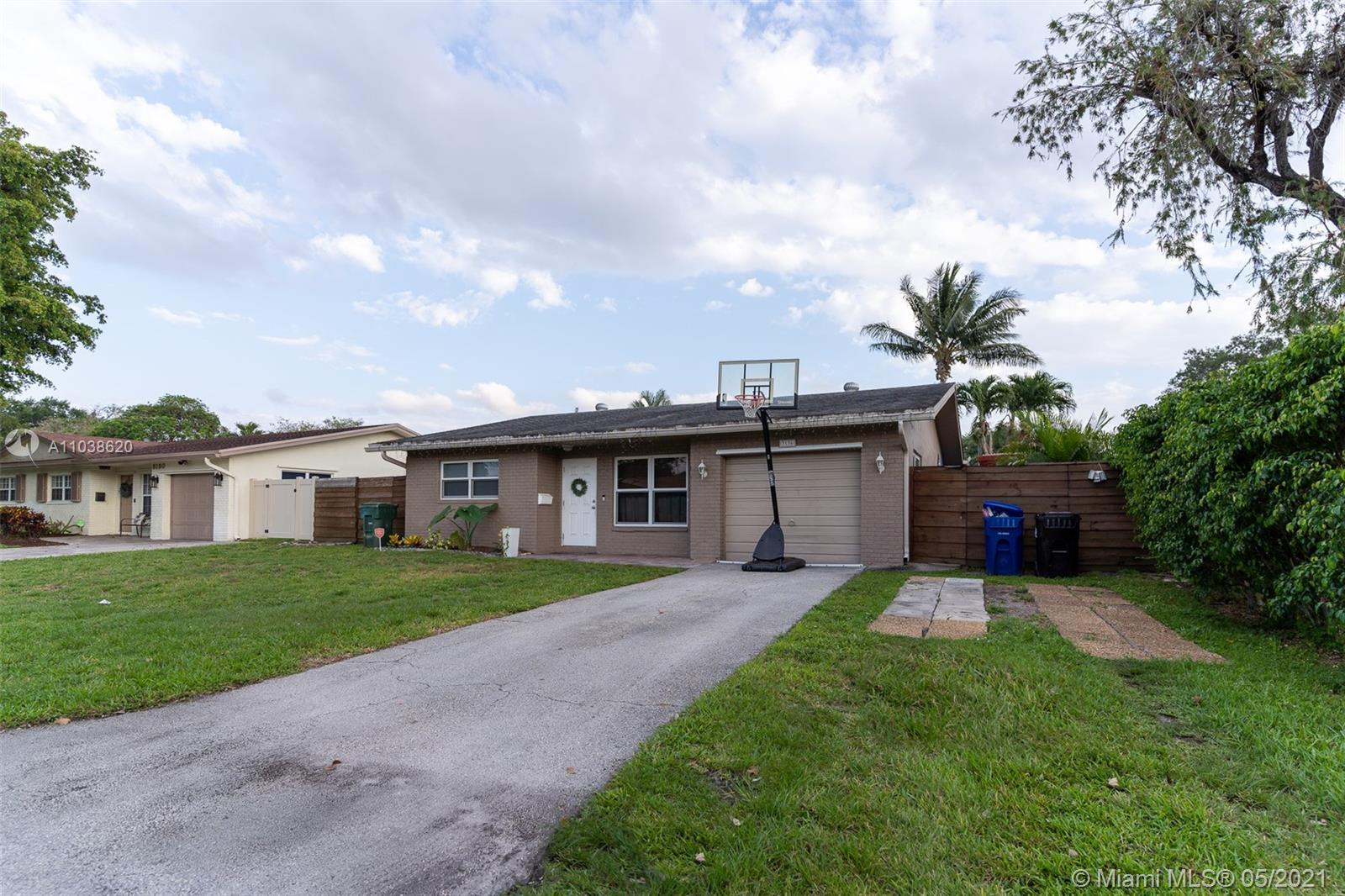 BRIGHT & SPACIOUS POOL HOME, LOCATED IN DESIRABLE PALM AIRE VILLAGE WEST. THIS 4-BEDROOM FAMILY HOME