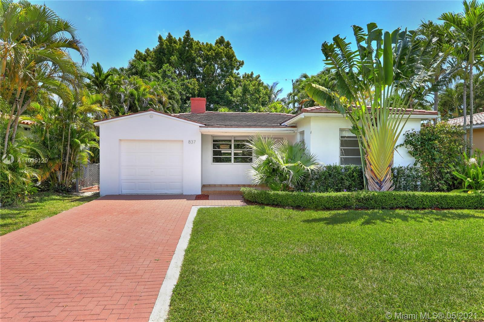 Charming cottage home on a quiet street in the North Gables.  Sit back and relax in the lovely front