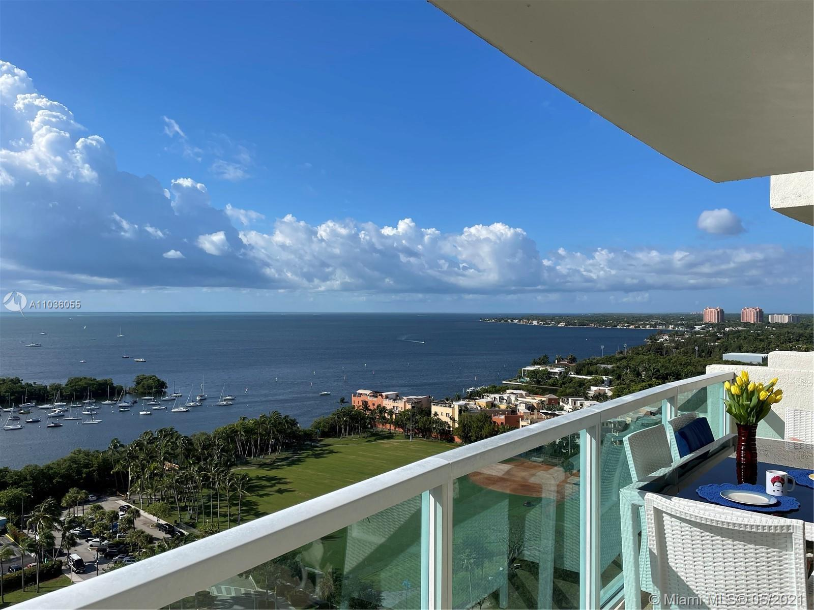 UNOBSTRUCTED WATER VIEWS! WRAP AROUND BALCONY. Prop. manager and maid service avail. Covered parking